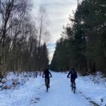 'Overall Winners' Sebastian ('Bash') and Barney undertake a snowy cycle ride 'on their travels' to John O'Groats! [Credit: WOODBRIDGE SCHOOL]